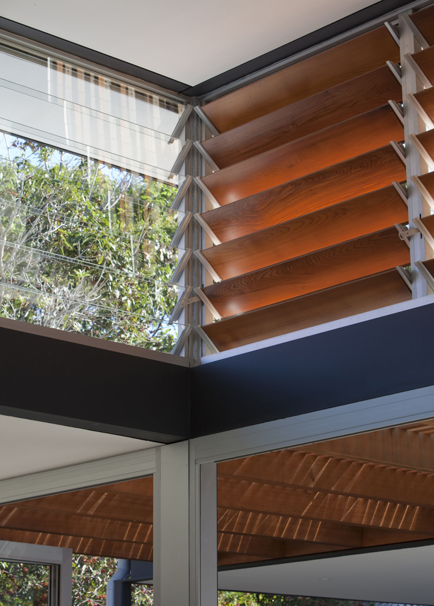 Lambert House by Sydney award winning residential architecture office Sam Crawford Architects. Operable louvers allow sunlight and ventilation to living space