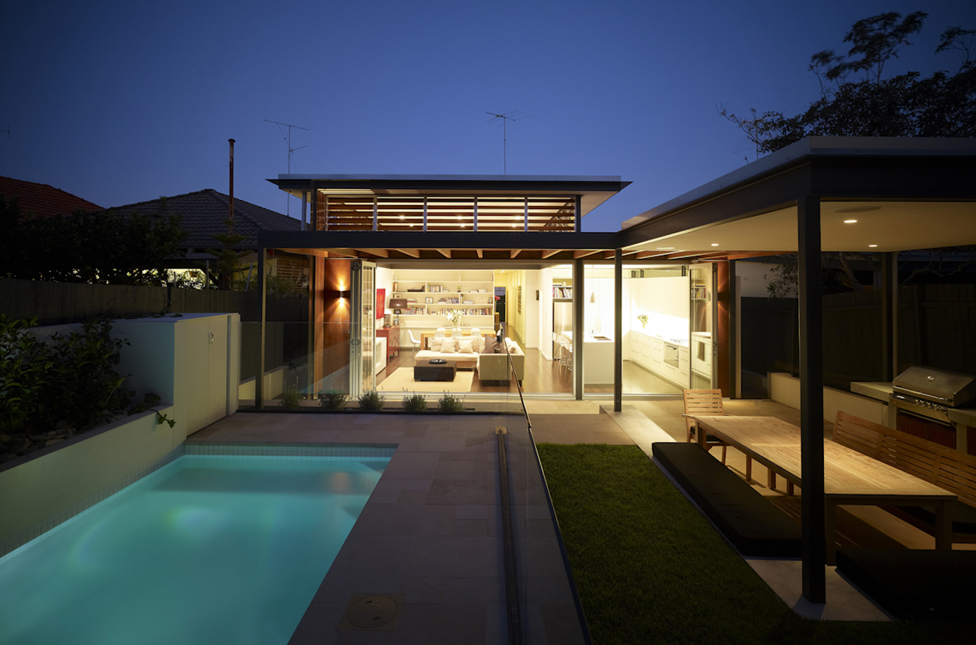 Lambert House by Sydney award winning residential architecture office Sam Crawford Architects. View to western facade at twilight