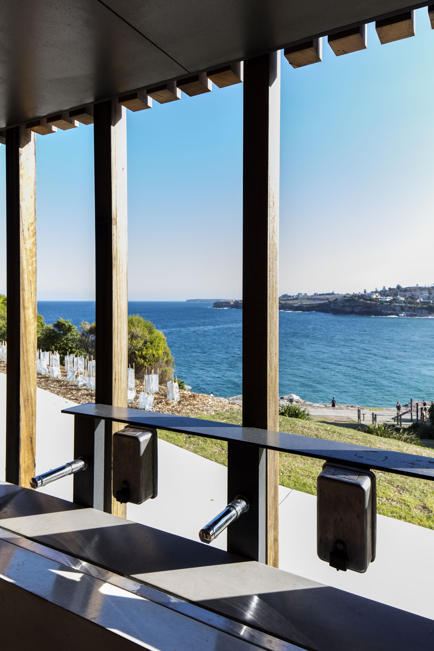 Marks Park Amenities by Sam Crawford Architects, view onto Bondi Bay from wash basin