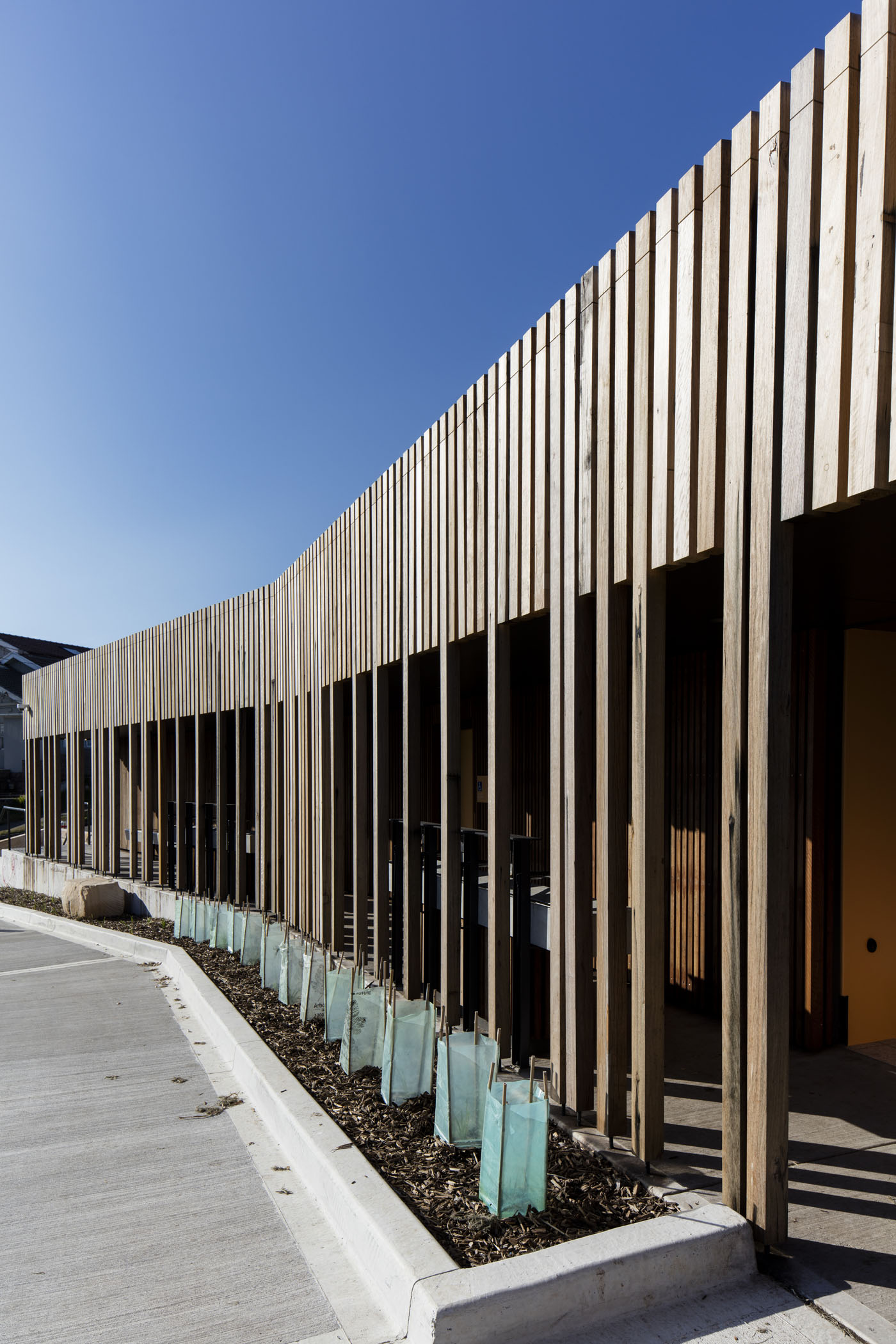 Marks Park Amenities by Sam Crawford Architects, south elevation facade and vegetation planted