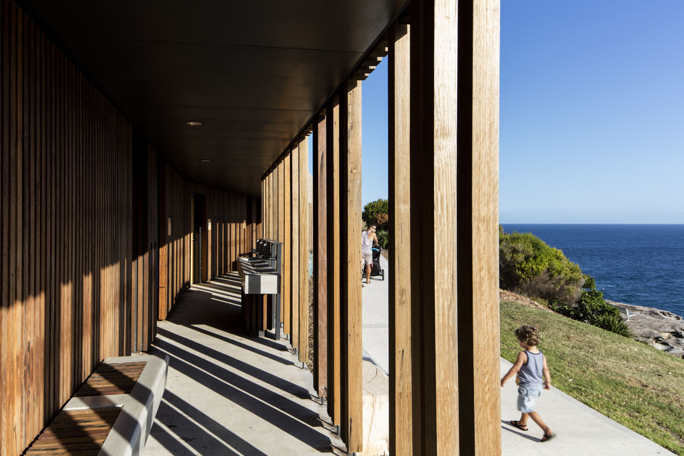 Marks Park Amenities by Sam Crawford Architects, sunny view along main walkway