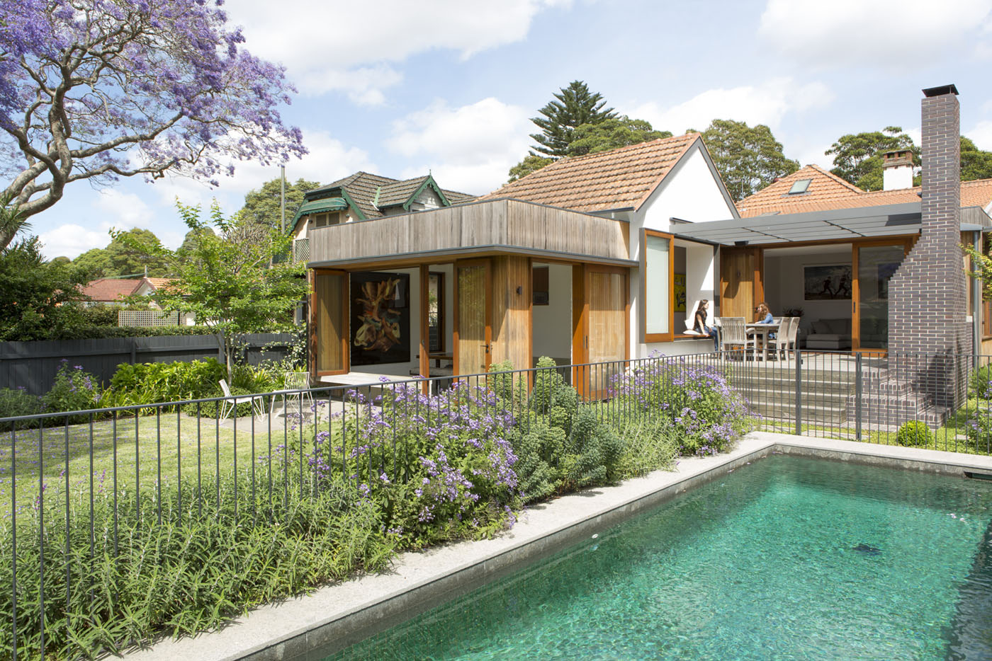 Denney House by Sam Crawford Architects, exterior poolside view.