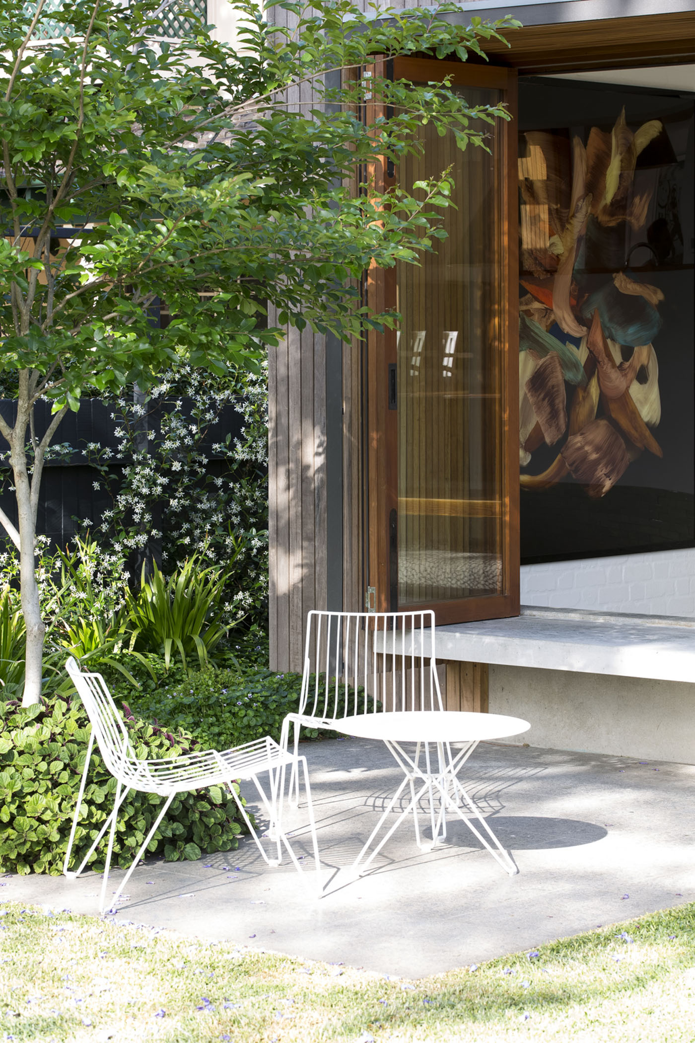 Denney House by Sam Crawford Architects, outdoor seating and garden