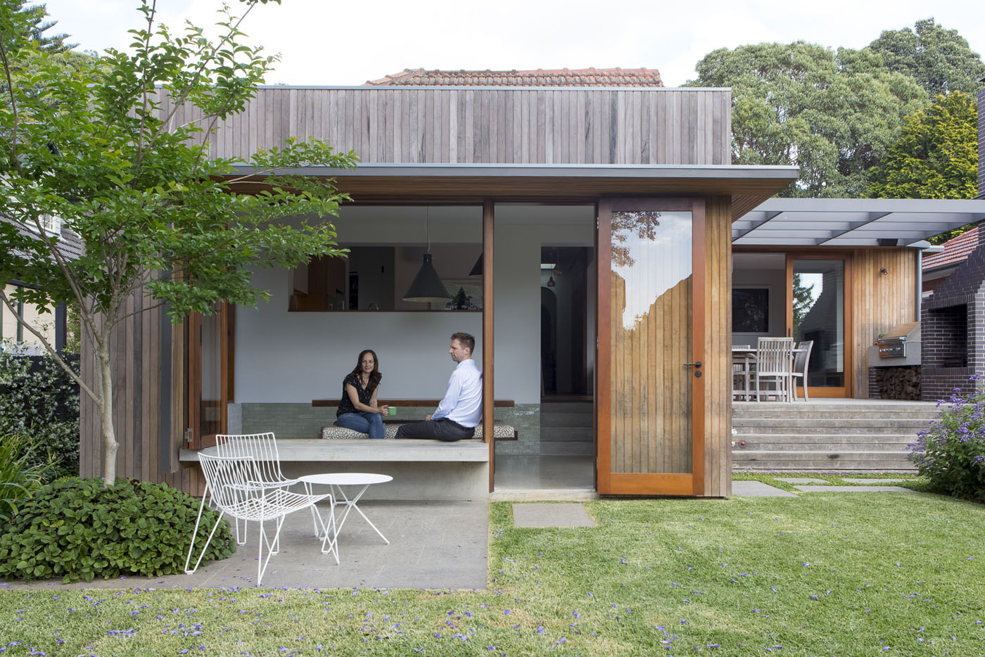 Denney House by Sam Crawford Architects, view to open backyard and seating