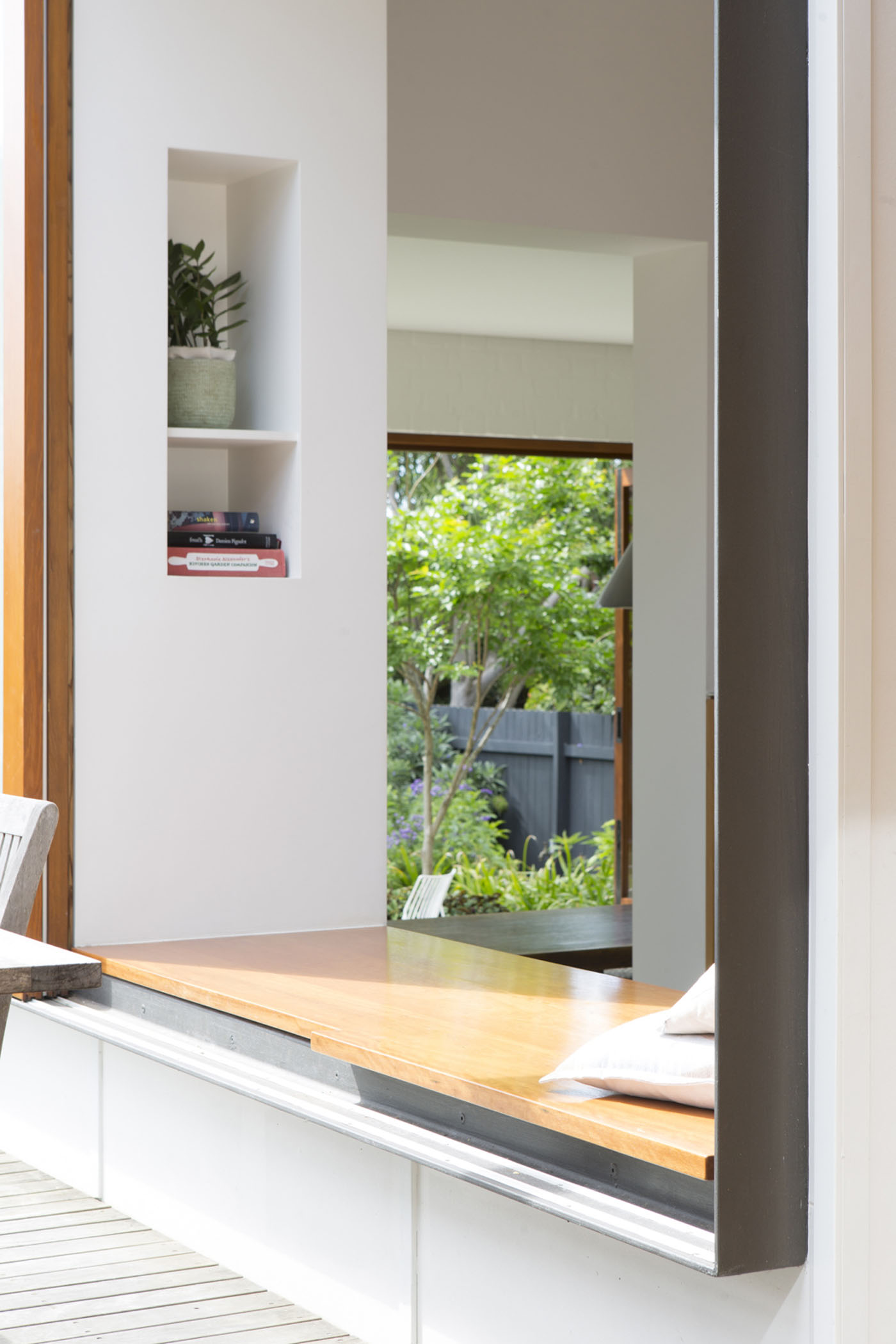 Denney House by Sam Crawford Architects, detail of the timber window seat