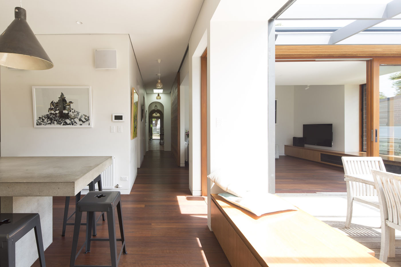 Denney House by Sam Crawford Architects, view to the corridor with arched openings