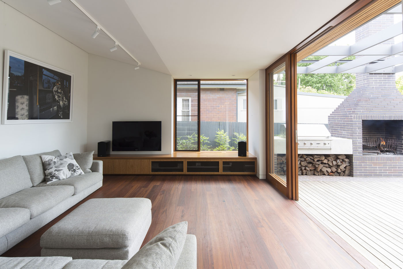 Denney House by Sam Crawford Architects, open living room connected to external barbecue area