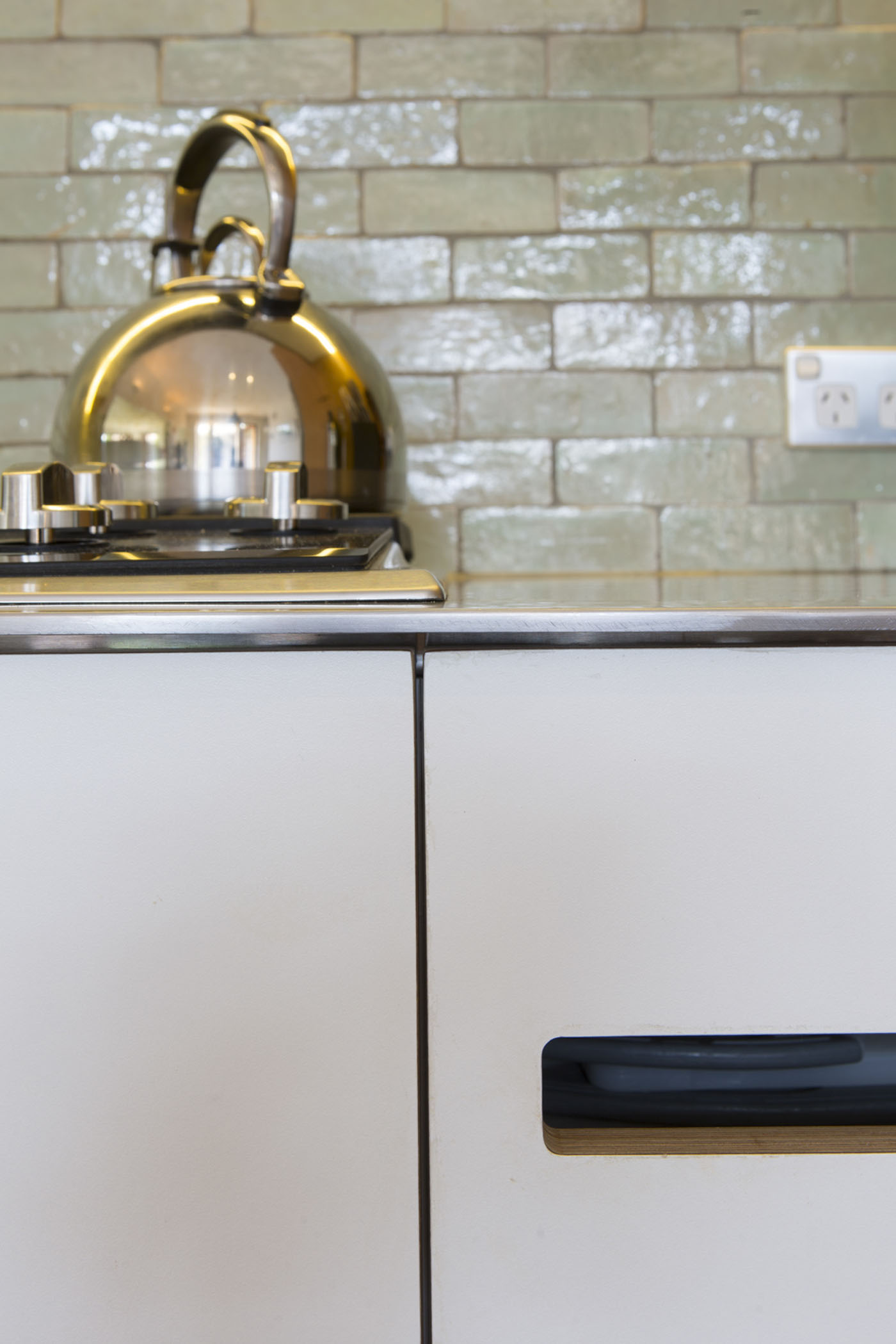 Denney House by Sam Crawford Architects, detail of kitchen cabinet and custom handle