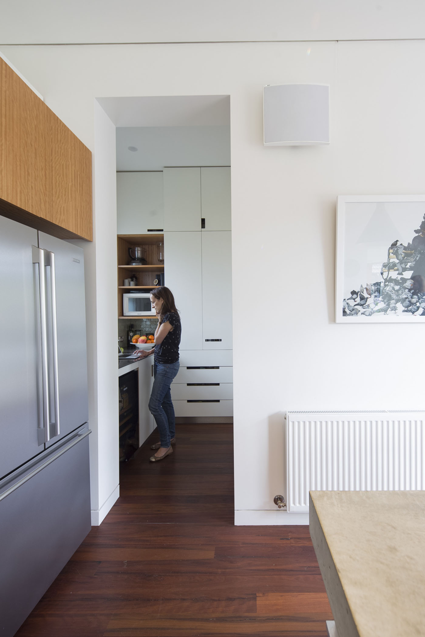 Denney House by Sam Crawford Architects, view to kitchen with person standing