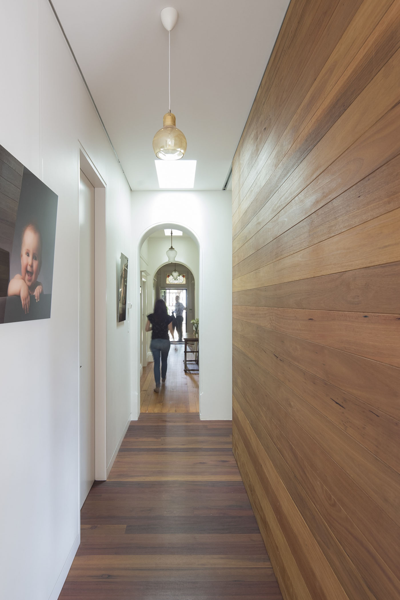 Denney House by Sam Crawford Architects, ironbark recycled hardwood floor and panelling in contrast with white painted walls