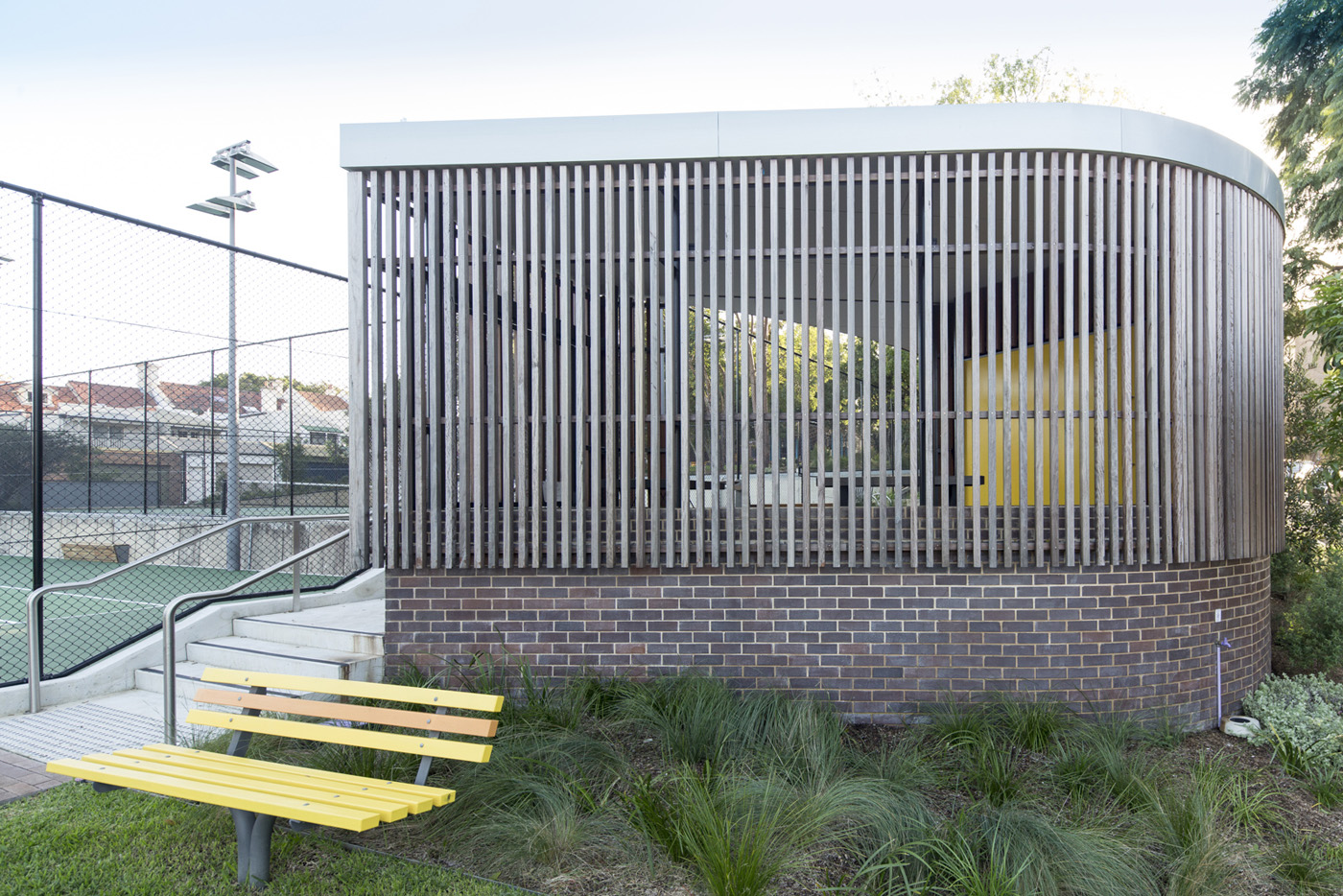 St James Park Amenities, wooden privacy screening and yellow texture.