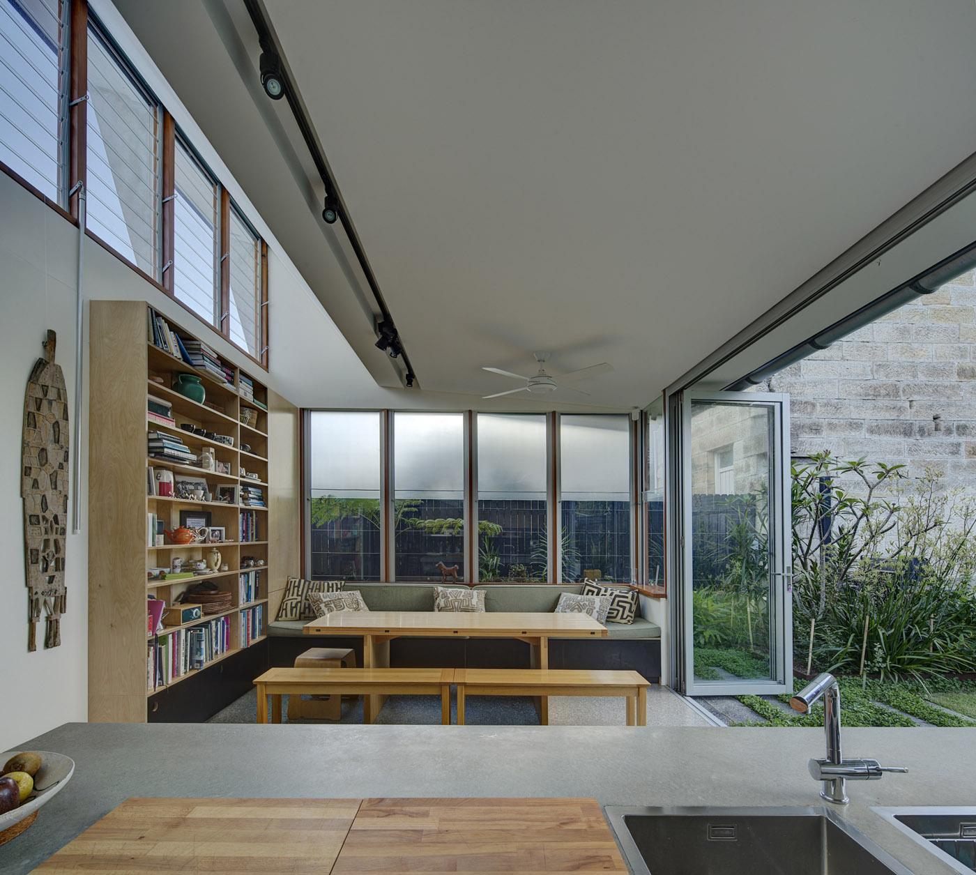 Salgo Kitching House by Sydney award winning architecture office Sam Crawford Architects. View to living area with celestial windows allowing natural light penetration.