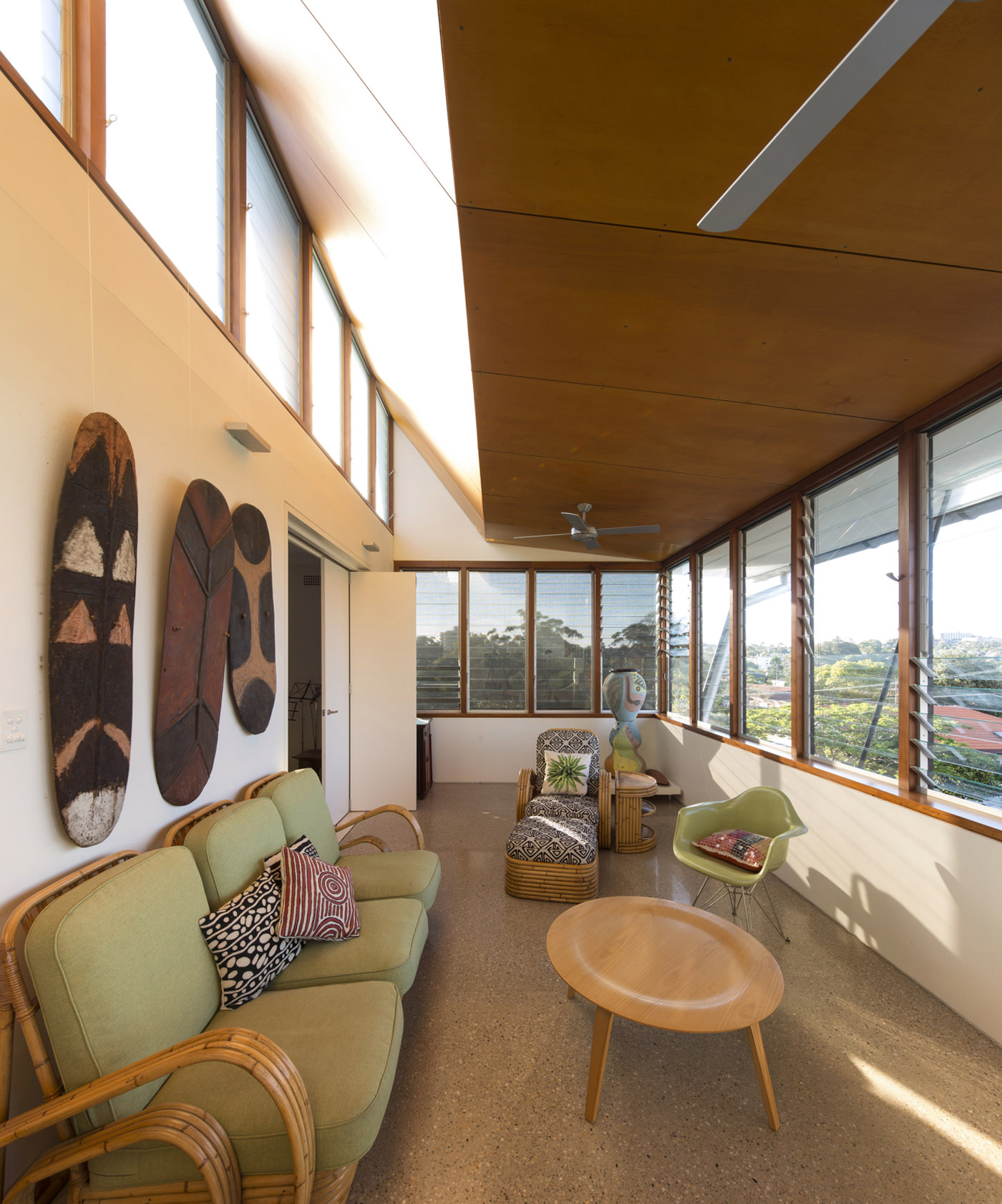 Salgo Kitching House by Sydney award winning architecture office Sam Crawford Architects. Folded timber lined ceiling and glass louver windows brings view into focus