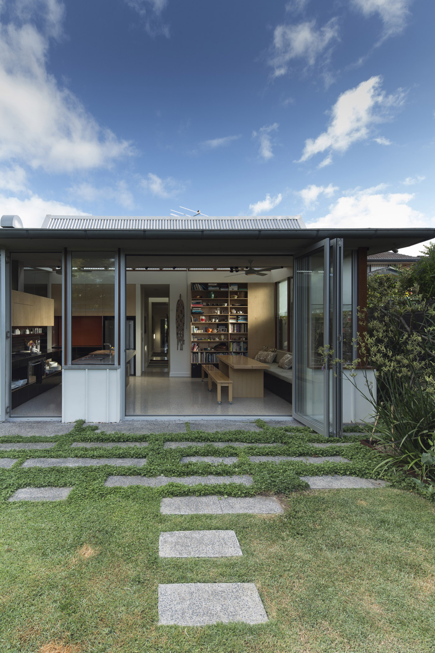 Salgo Kitching House by Sydney award winning architecture office Sam Crawford Architects. Granite paver steps leading to house