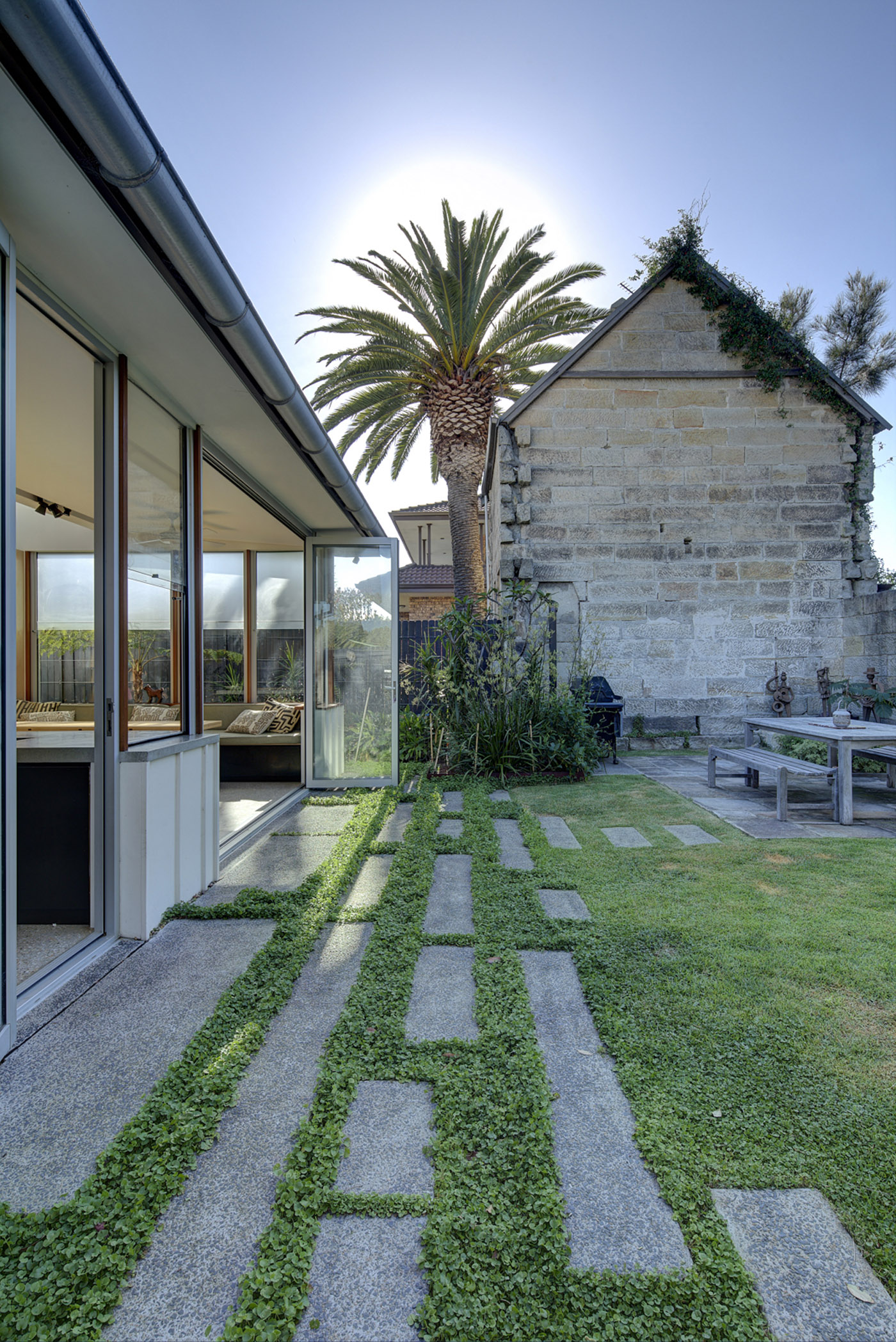 Salgo Kitching House by Sydney award winning architecture office Sam Crawford Architects. View from backyard to heritage listed neighbouring house