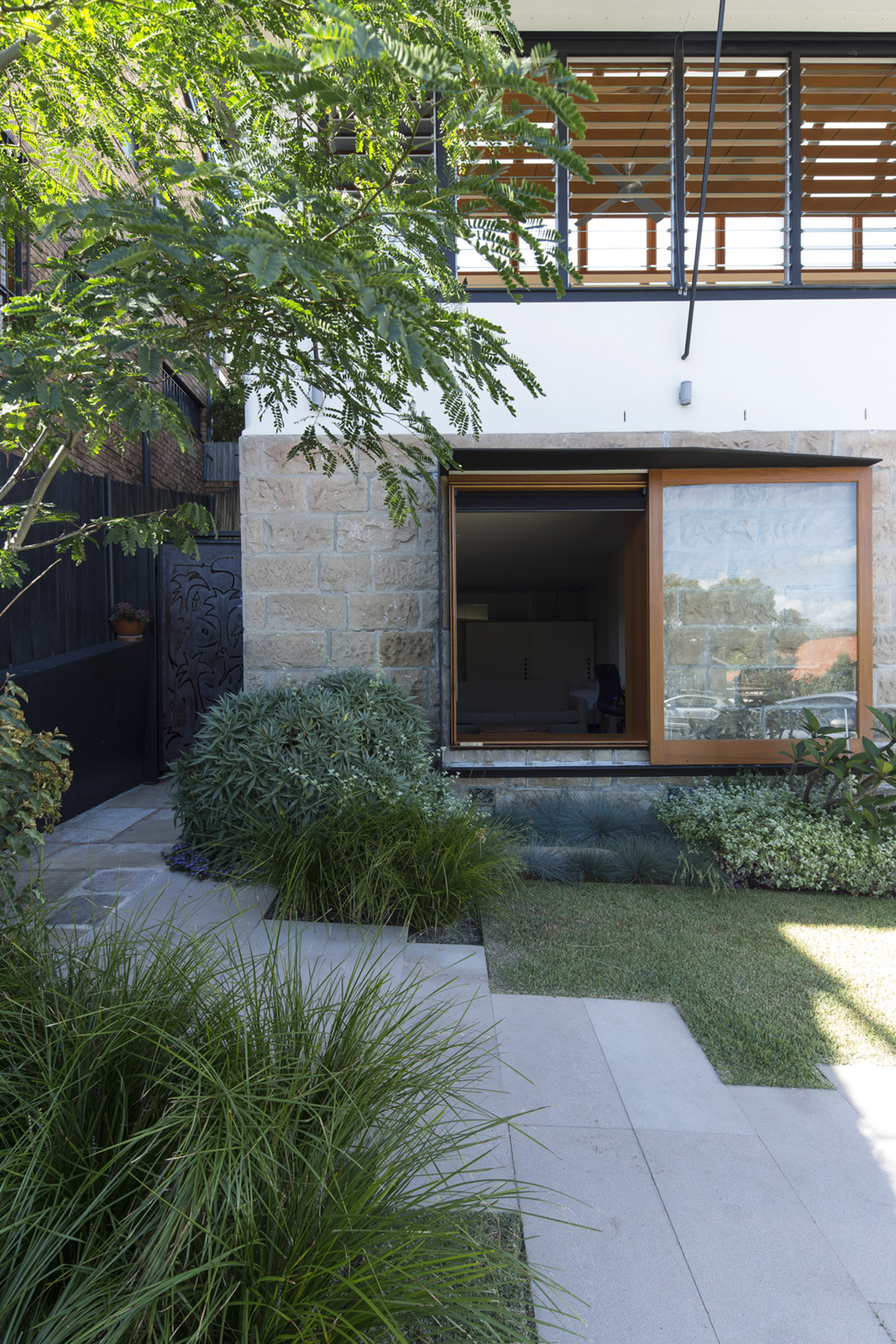 Salgo Kitching House by Sydney award winning architecture office Sam Crawford Architects. View to house from backyard.