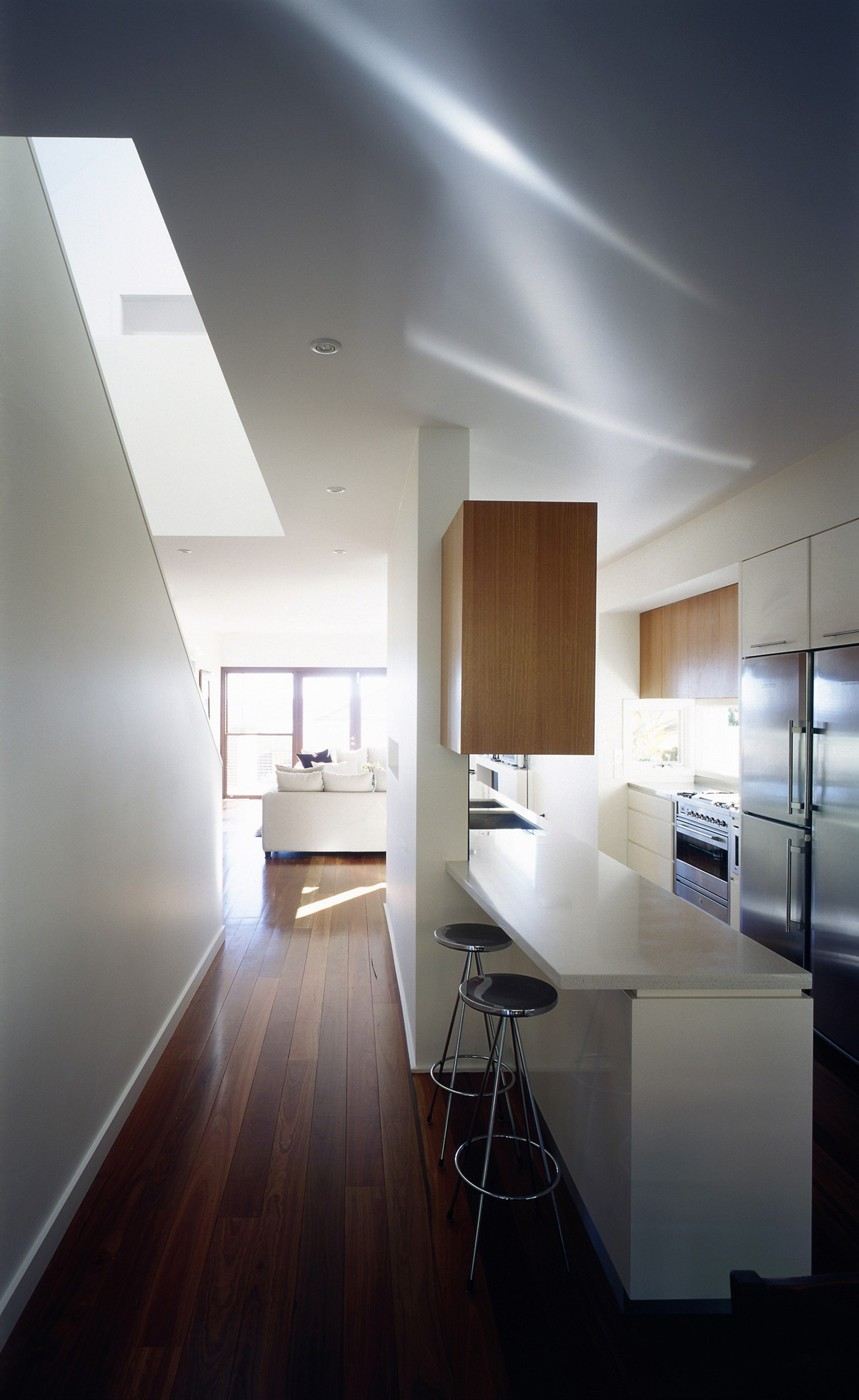 Harbour House by Sydney award winning residential architecture office Sam Crawford Architects. Light well allows natural light to corridor.
