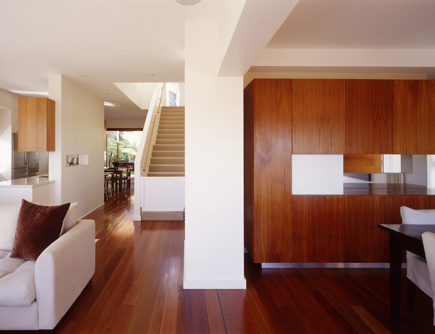 Harbour House by Sydney award winning residential architecture office Sam Crawford Architects. Spotted gum timber floors seamlessly connect living areas.