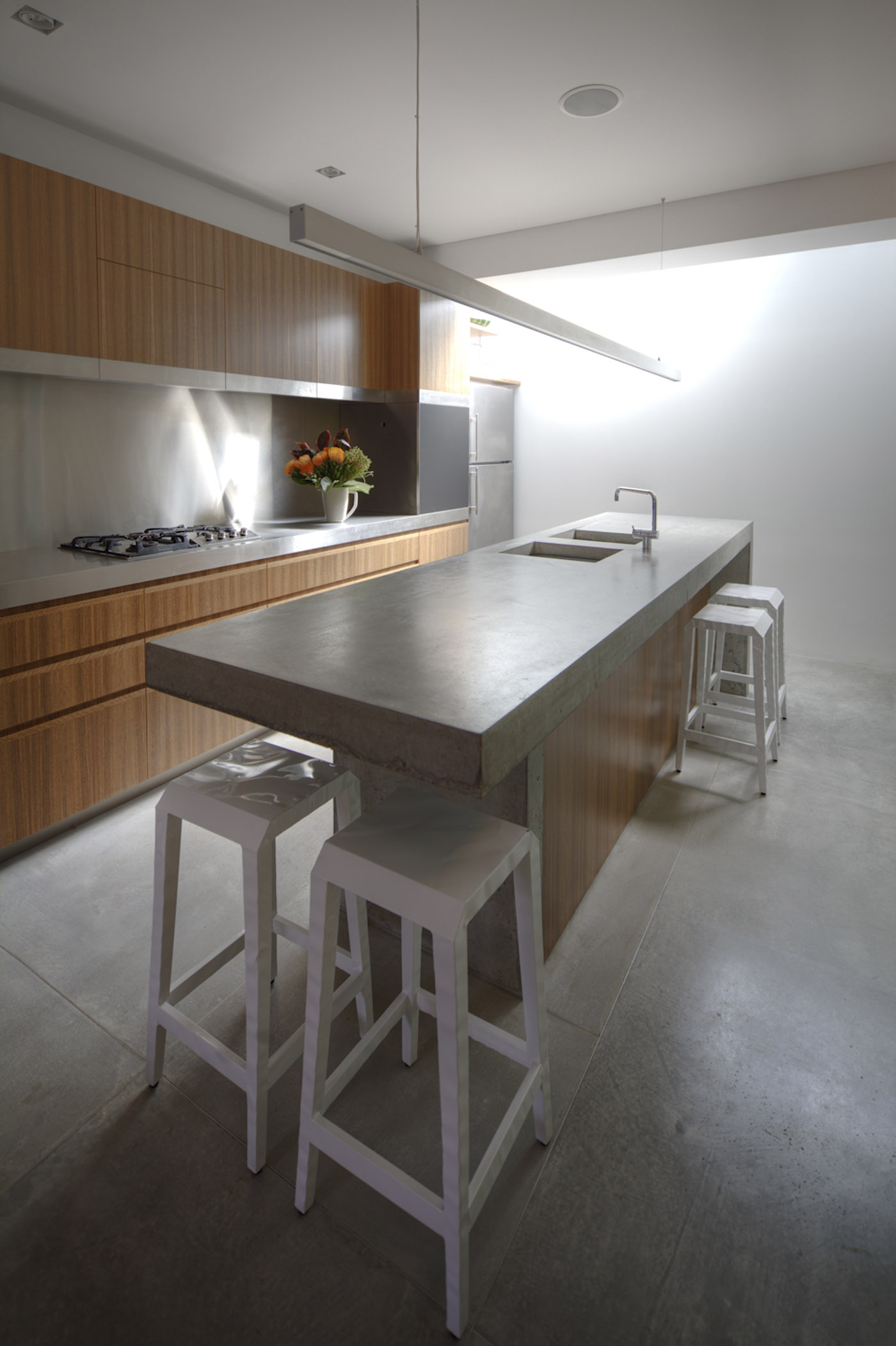 Newtown Terrace by award winning Sydney firm Sam Crawford Architects. Minimal concrete, stainless steel and timber kitchen