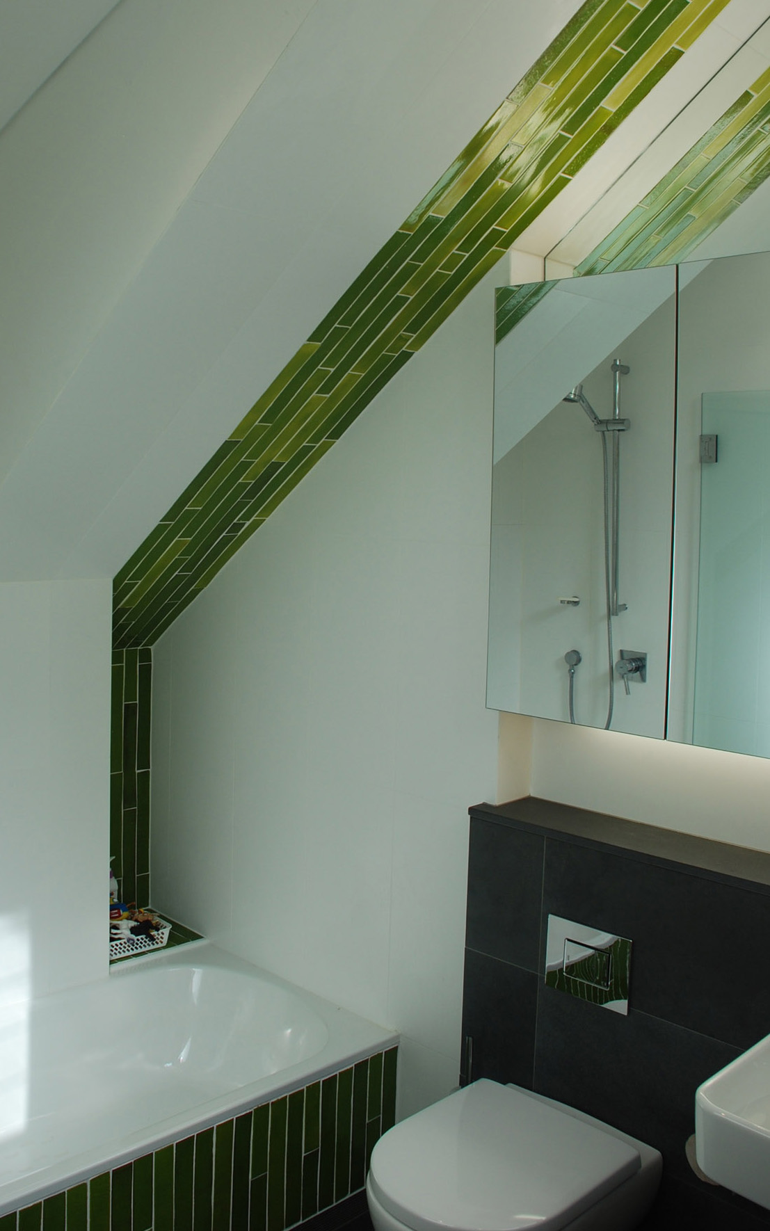 Cardigan Street by Sydney award winning residential architecture office Sam Crawford Architects. Bathroom green tile feature