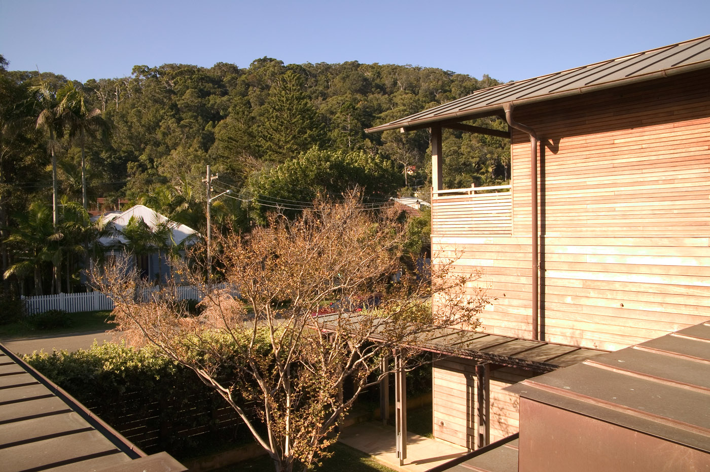 Pittwater House by Sydney award winning residential architecture office Sam Crawford Architects. View from upstairs to open courtyard downstairs