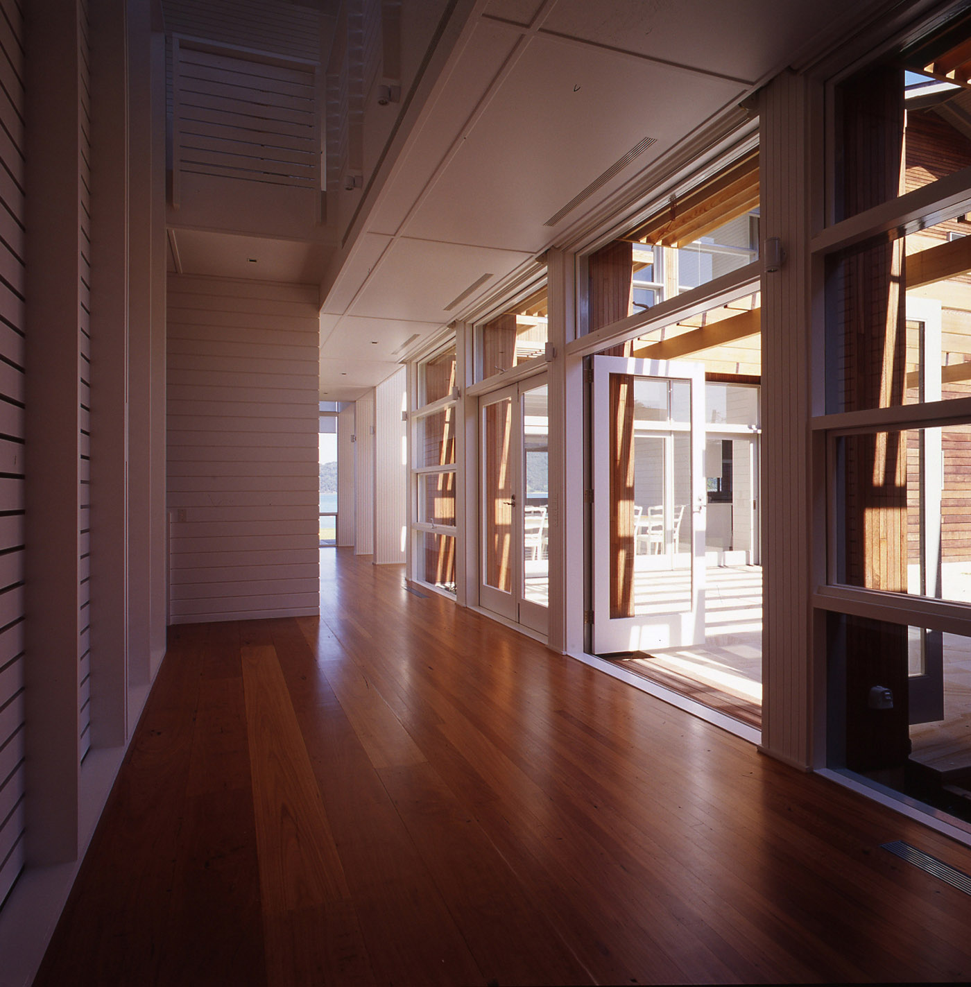Pittwater House by Sydney award winning residential architecture office Sam Crawford Architects. Corridor connected to courtyard.