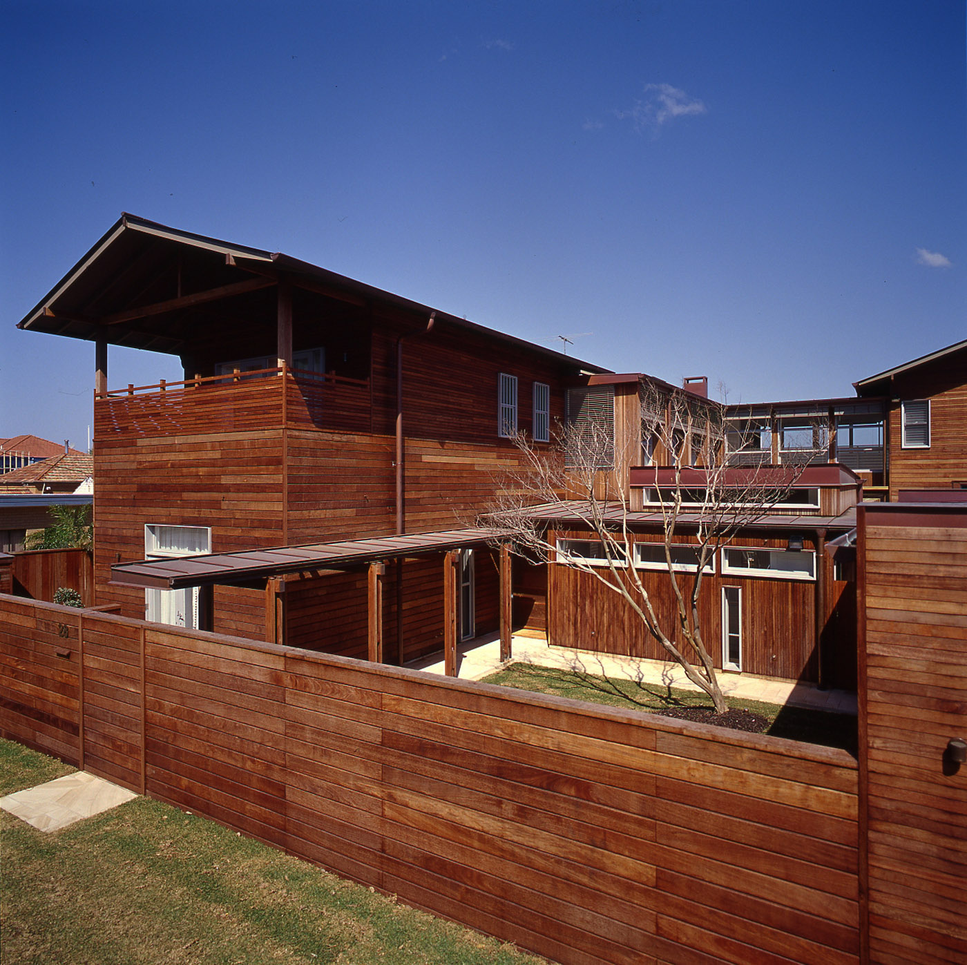 Pittwater House by Sydney award winning residential architecture office Sam Crawford Architects. Kwila timber cladding allows building to age naturally.