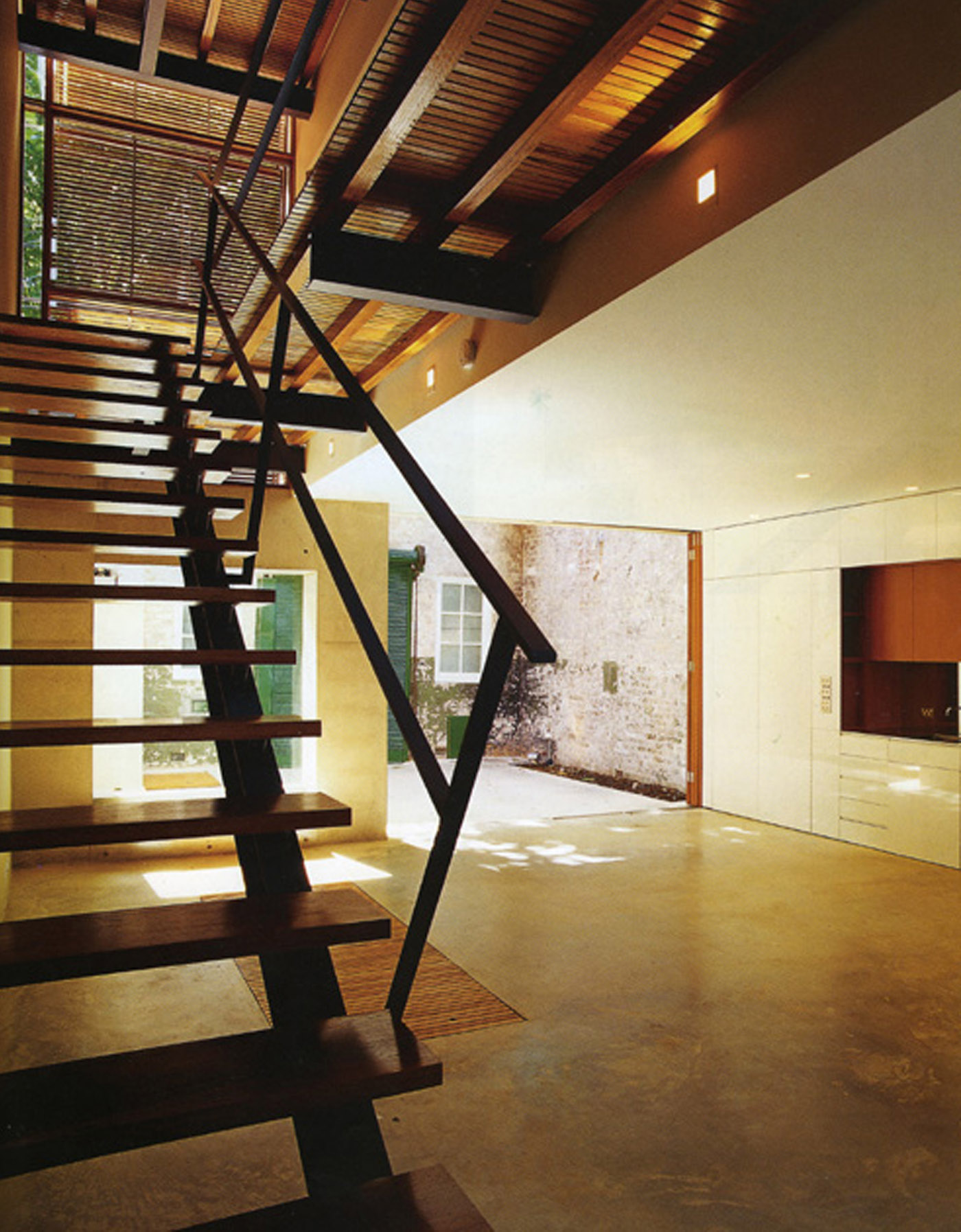 Substation House by award winning residential architecture firm Sam Crawford Architects. View of light open stairs