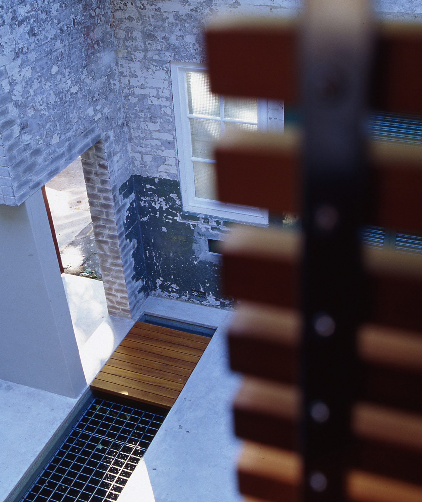Substation House by award winning residential architecture firm Sam Crawford Architects. View from upstairs to the front brickwork entrance