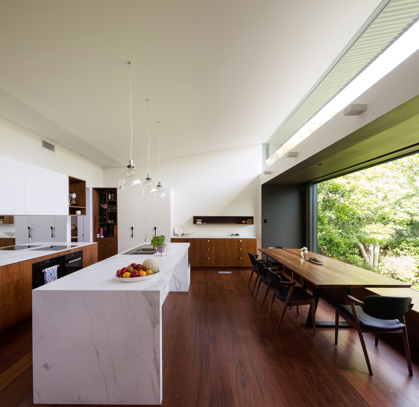 Roseville House by Sydney residential architects Sam Crawford Architects. This modern addition is open plan, here showing the light filled kitchen living areas.