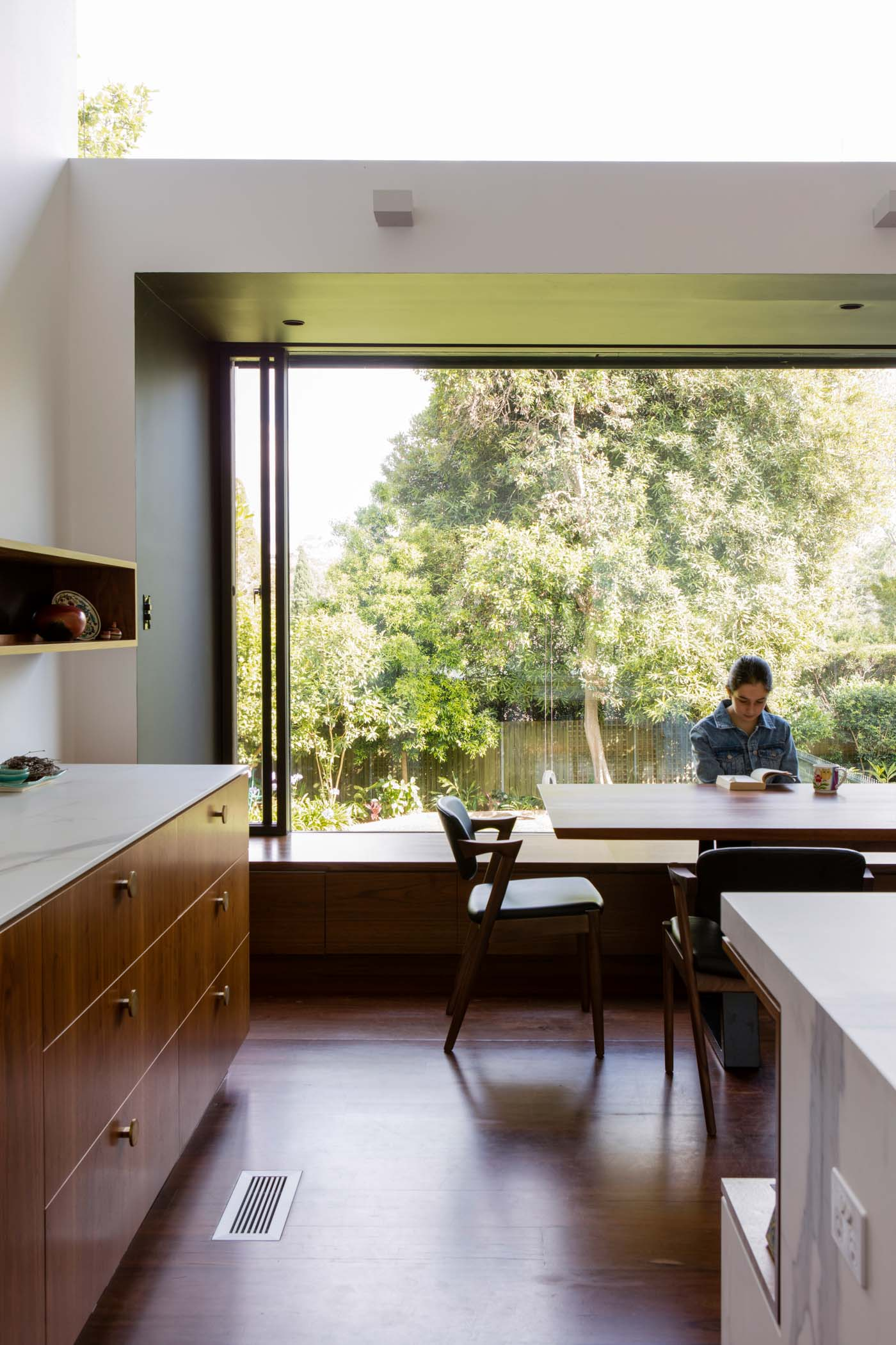 Roseville House by Sydney residential architects Sam Crawford Architects. The large windows forming seats are a seamless connection to the garden.