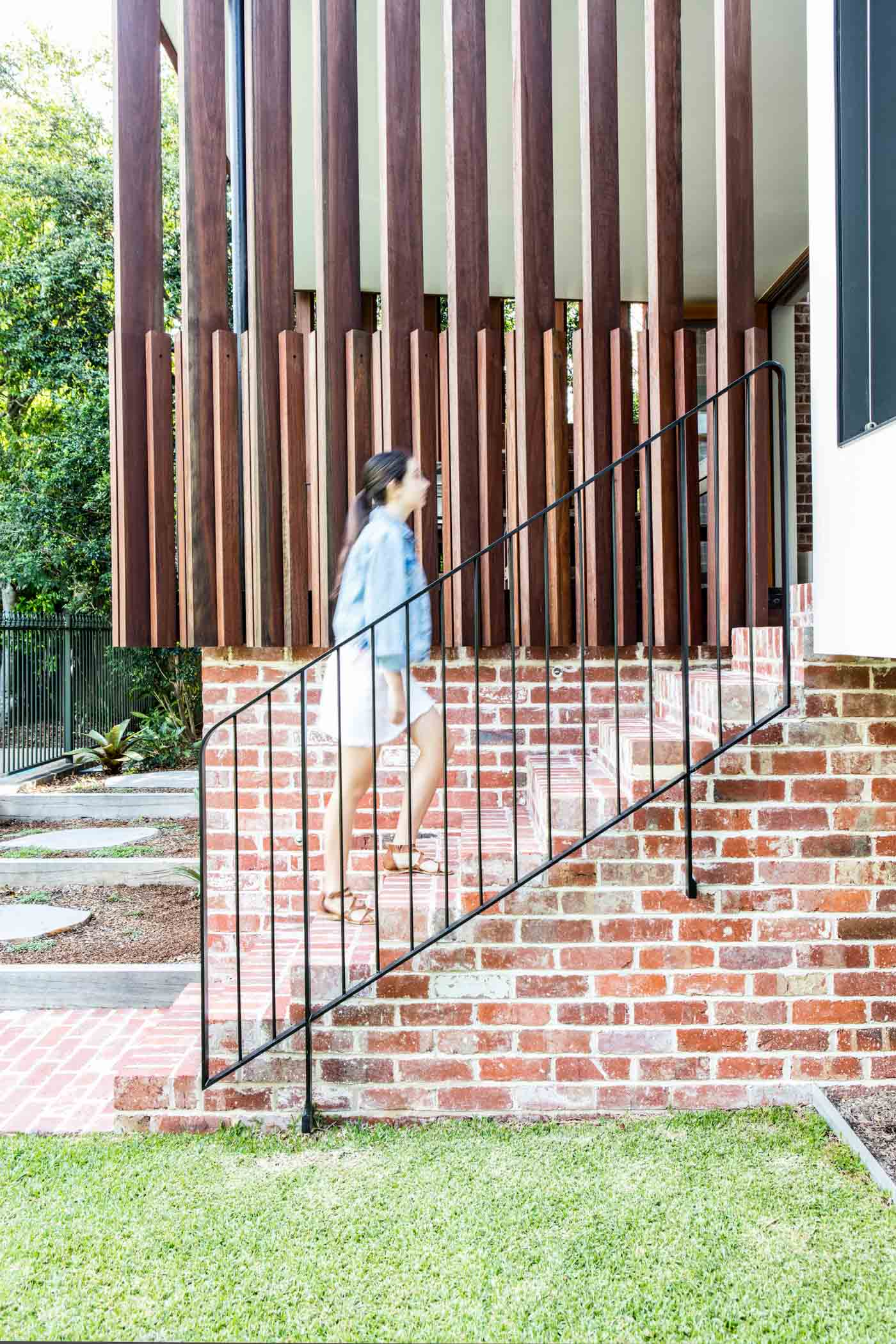 Roseville House by Sydney residential architects Sam Crawford Architects. Intricate brickwork and timber screens provide a link to the yard.