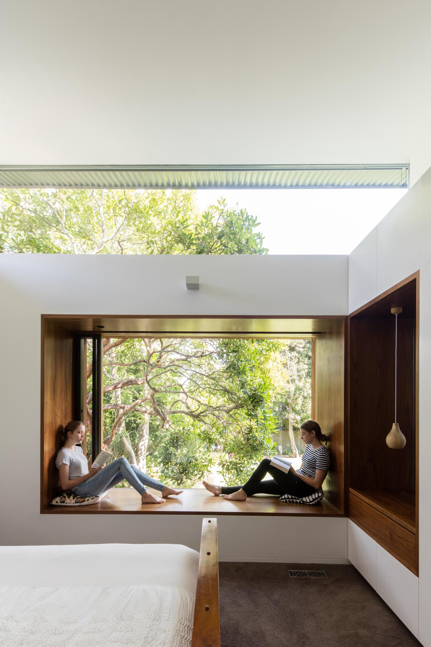 Roseville House by Sydney residential architects Sam Crawford Architects. This modern addition creates a private bedroom with garden out look.