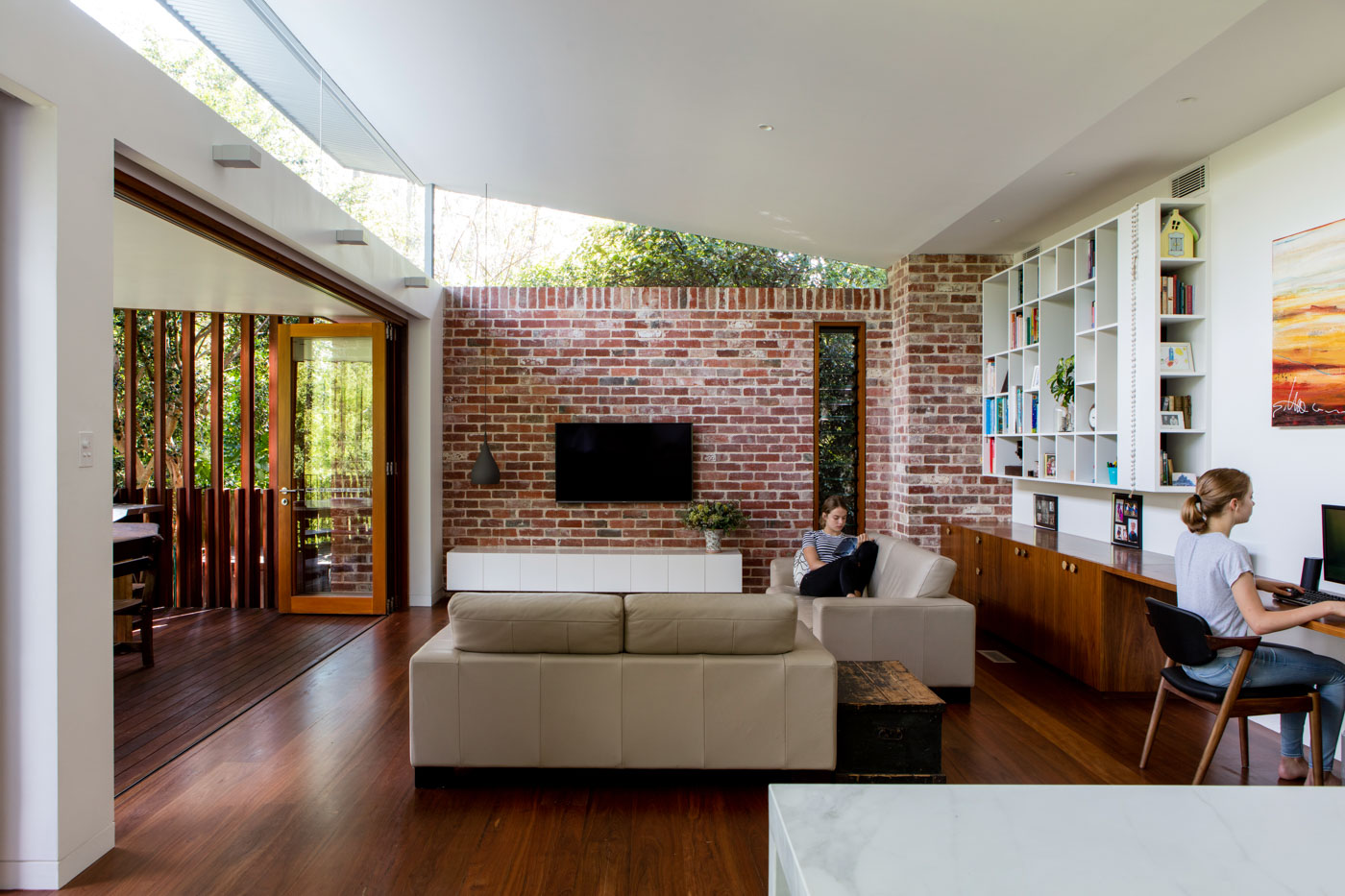 Roseville House by Sydney residential architects Sam Crawford Architects. This modern addition has high level windows bringing light in.