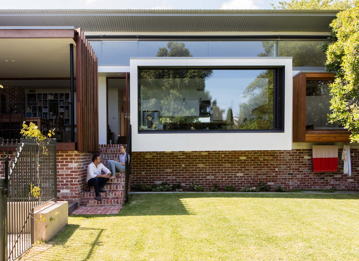 Roseville House by Sydney residential architects Sam Crawford Architects. This modern addition has large window pop outs protruding into the garden.