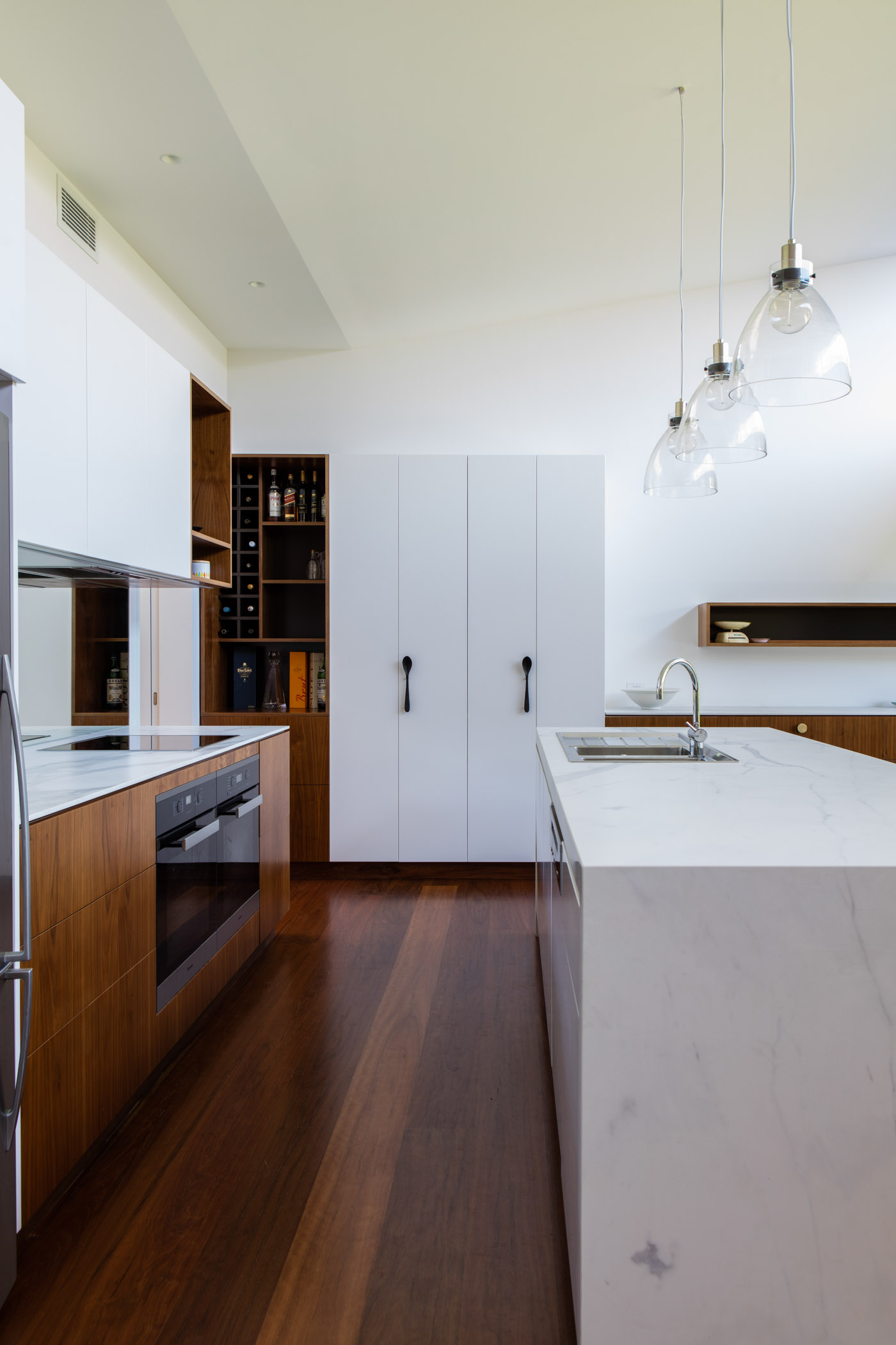 Roseville House by Sydney residential architects Sam Crawford Architects. This modern, bespoke kitchen.