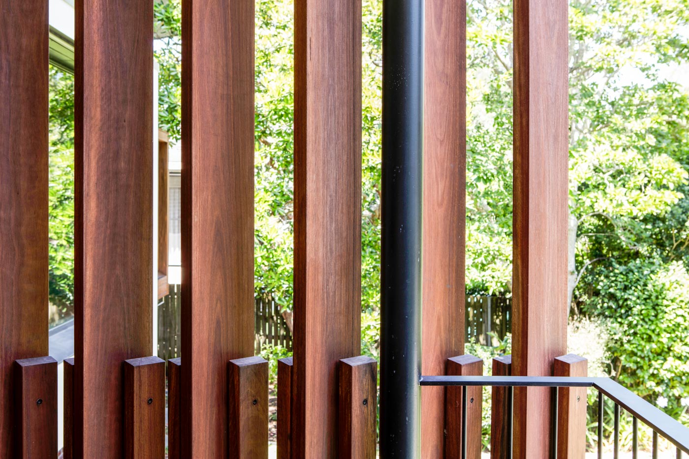 Roseville House by Sydney residential architects Sam Crawford Architects. Detailed timber screens provide privacy and direct the views.