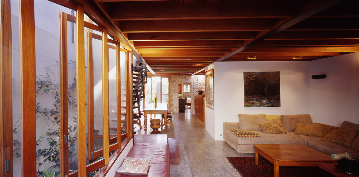 Bandi Drew House by Sydney award winning residential architecture firm Sam Crawford Architects. View to light filled living room and dining.