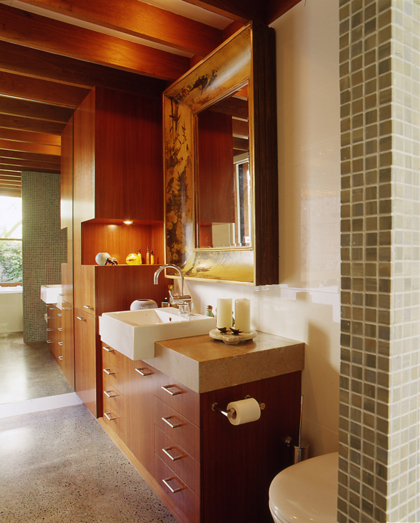 Bandi Drew House by Sydney award winning residential architecture firm Sam Crawford Architects. Ambient bathroom with integrated timber veneer joinery