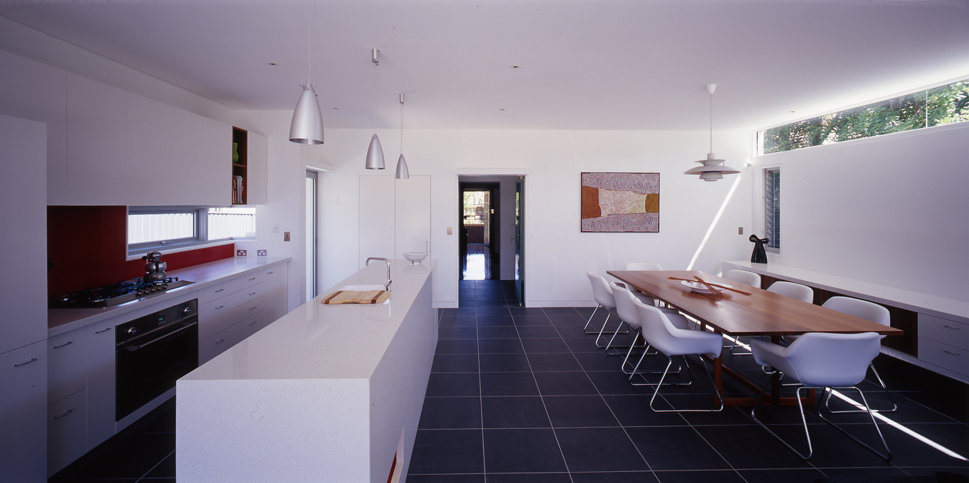 Caristo House by award winning residential architecture office Sam Crawford Architects. Open plan living and dining space with skylight and light suspension