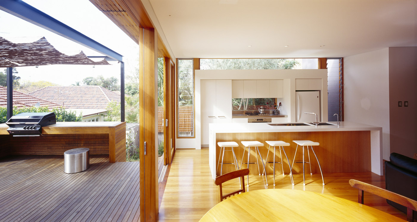 Cooper House by Sydney award winning residential architecture office Sam Crawford Architects. Timber sliding door allow flexibility to connect kitchen and outdoor bbq