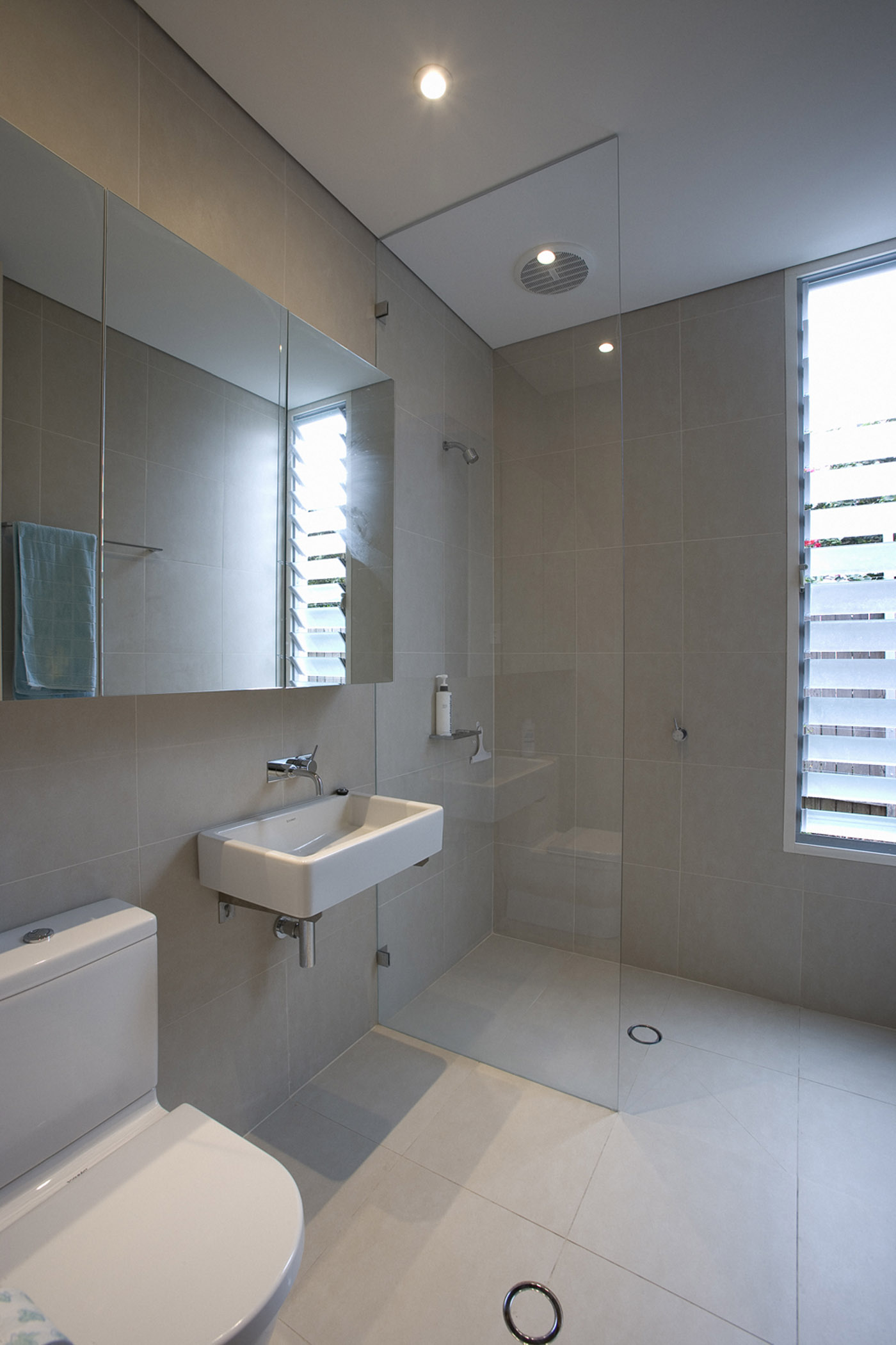 Cooper House by Sydney award winning residential architecture office Sam Crawford Architects. Bianco tile bathroom floor and wall.