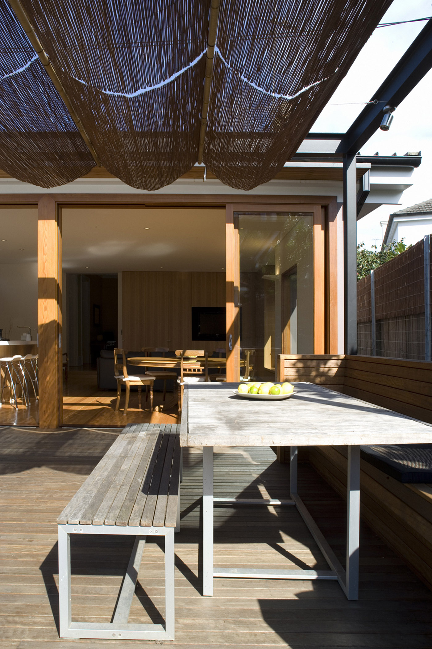 Cooper House by Sydney award winning residential architecture office Sam Crawford Architects. Outdoor bbq seating area.