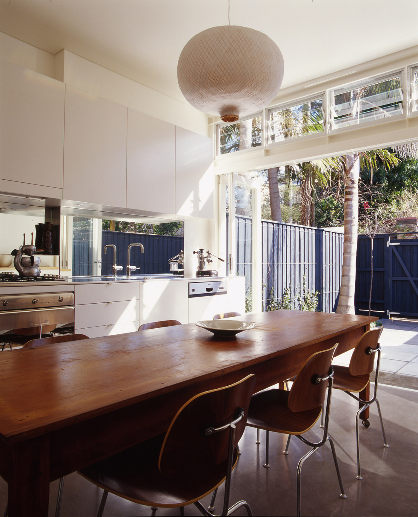 Wake Murphy House by Sydney award winning residential architecture office Sam Crawford Architects. Dining area adjacent to kitchen unit