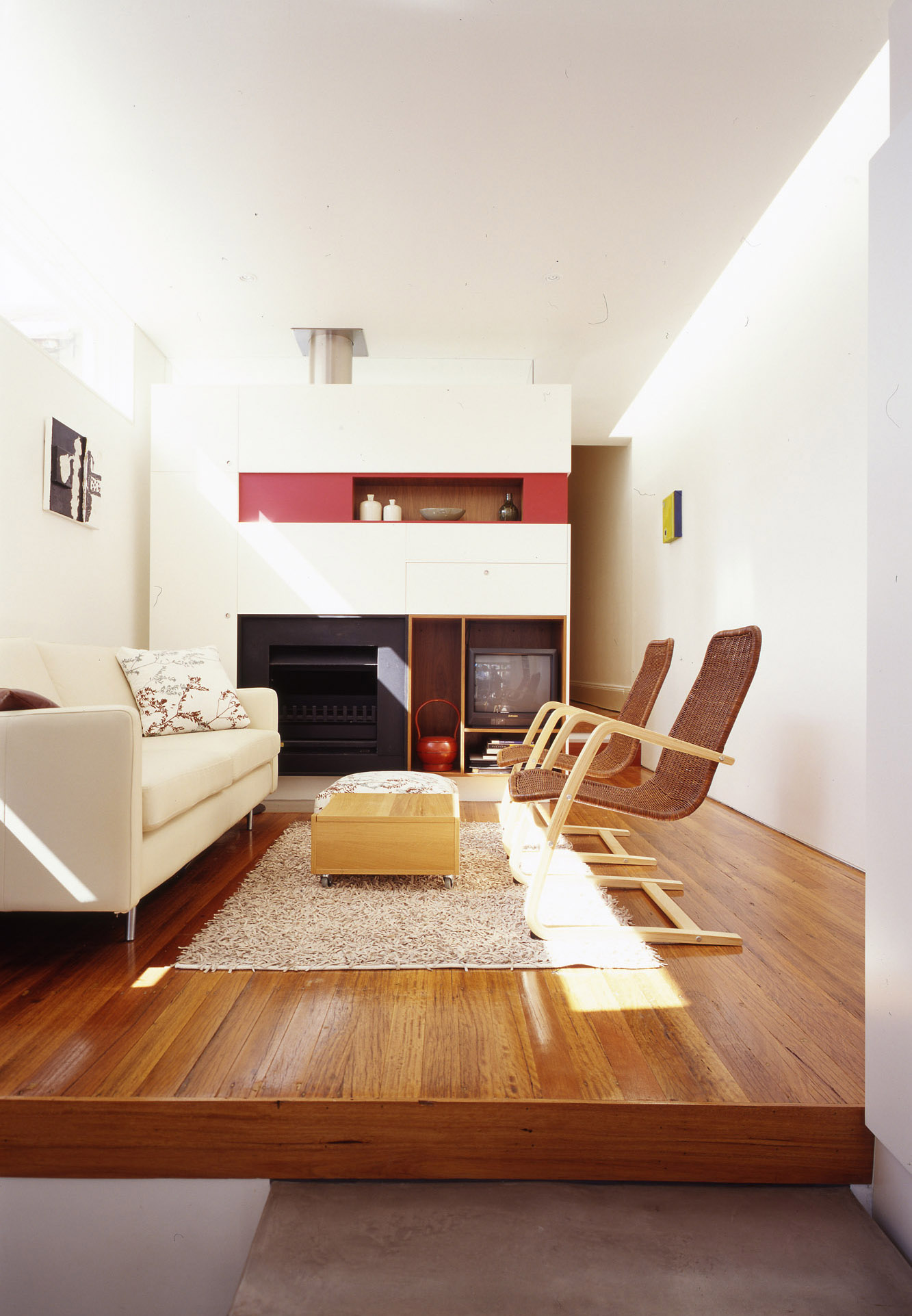 Wake Murphy House by Sydney award winning residential architecture office Sam Crawford Architects. Raised living room timber floor.