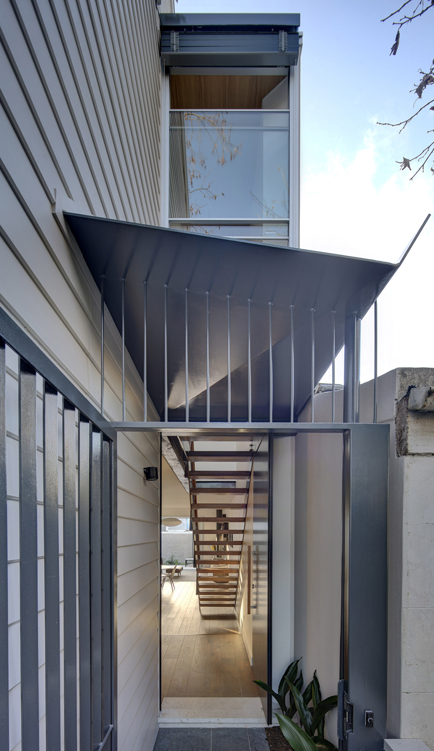 Gandha Kariappa Terrace by Sydney residential architects Sam Crawford Architects. View from entry into light-filled timber interiors
