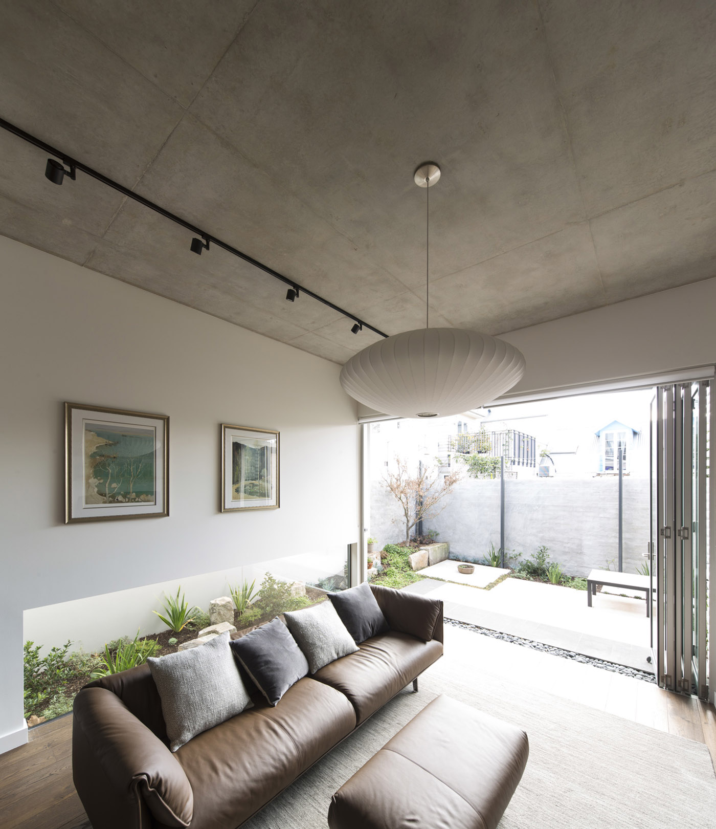 Gandha Kariappa Terrace by Sydney residential architects Sam Crawford Architects. View to light, open and tranquil living room