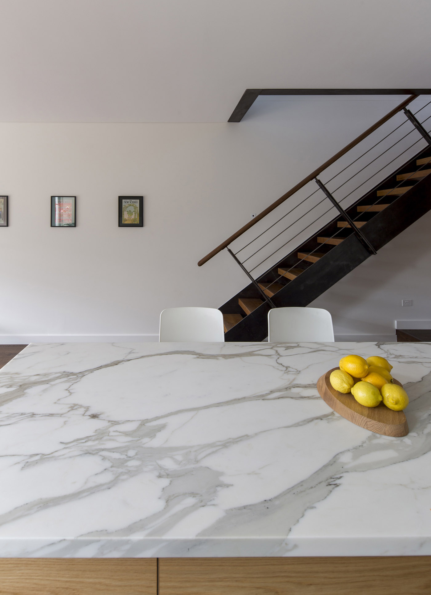 Gandha Kariappa Terrace by Sydney residential architects Sam Crawford Architects. Beautiful use of marble, timber and powder coated steel gives characteristic to this Australian home
