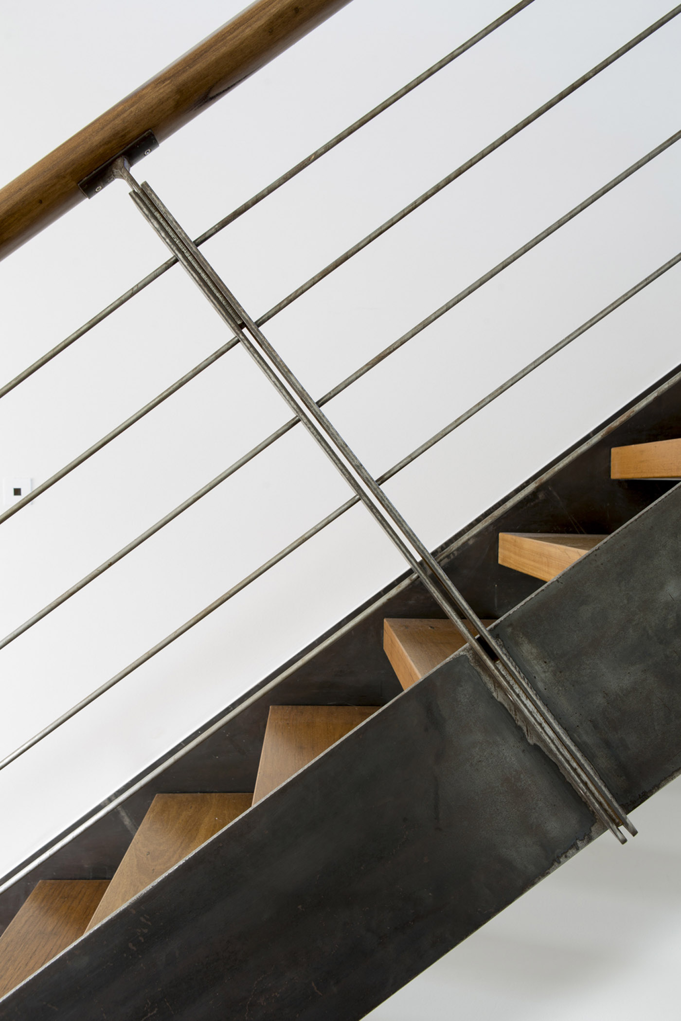 Gandha Kariappa Terrace by Sydney residential architects Sam Crawford Architects. Beautiful detail of the custom designed steel stair balustrade and timber handrail