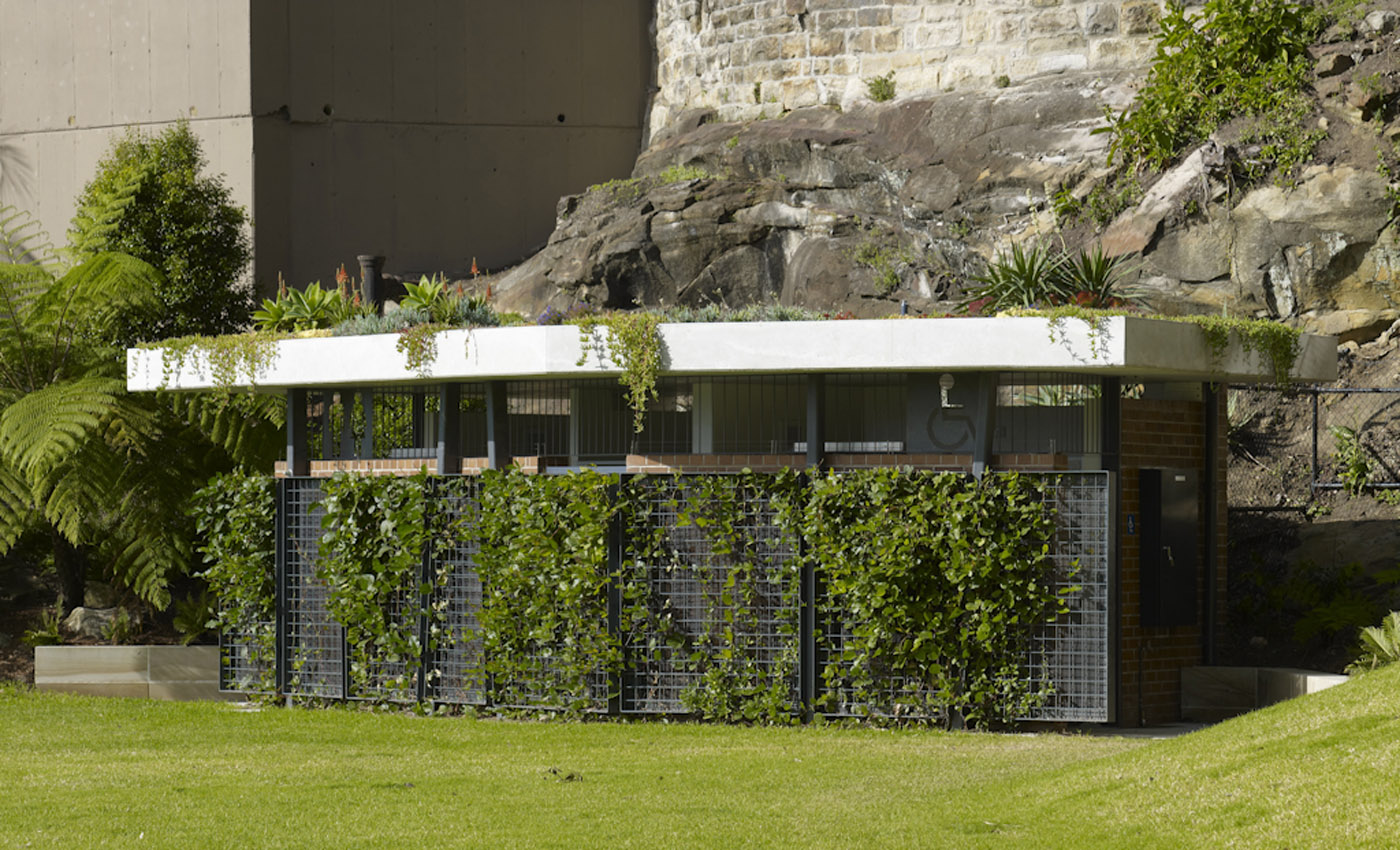 Beare Park Amenities by award winning Sydney public architecture firm Sam Crawford Architects. Green façade and green roof blends with the surrounding